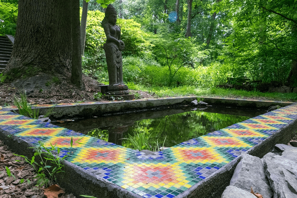 "Reflecting pond featuring a mosaic inspired by Allyson Grey's ""Order."" Mosaic made in collaboration with Allyson Grey, Cory Glory, Vishnu Dass, and Genevieve Wood."