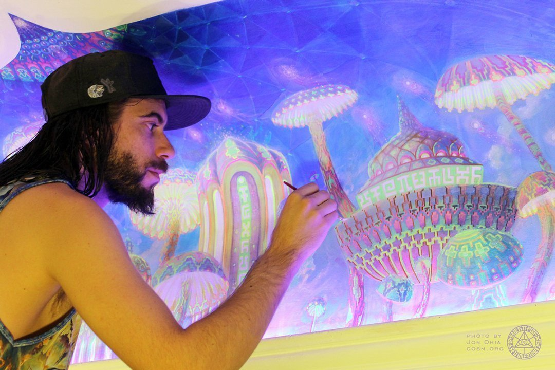 Jonathan Solter painting Mushroom Cafe mural