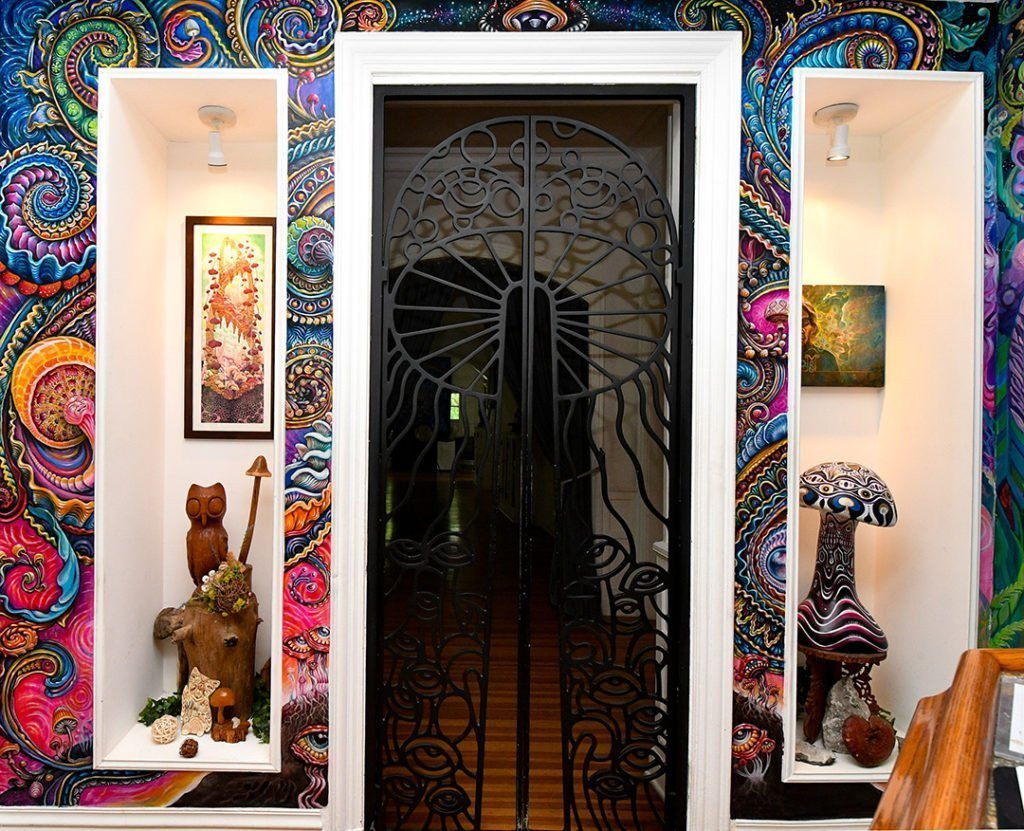 Randal Roberts and Morgan Mandala collaborated in a seamless explosion of wall-to-wall nighttime florals & paisleys around the doors Alex Grey designed.
